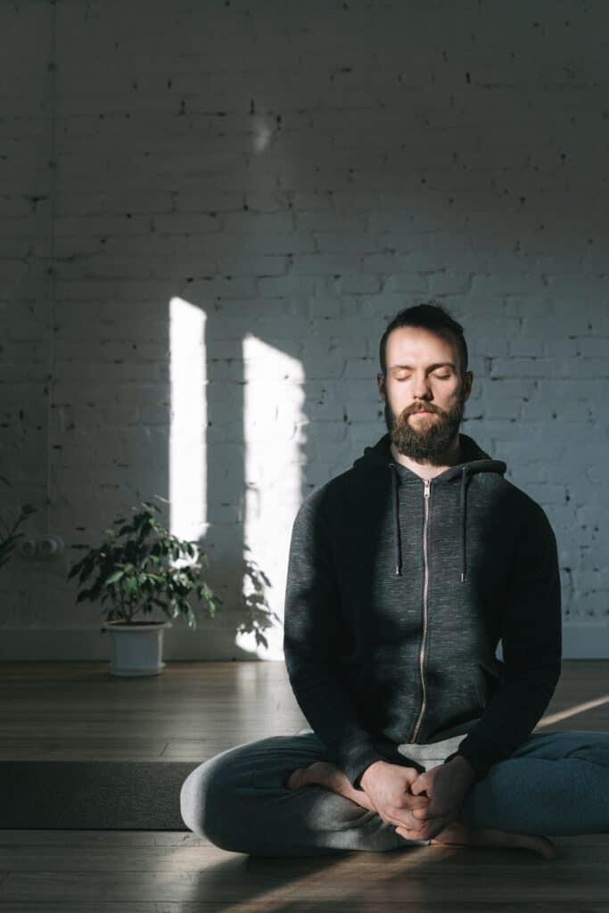 Man practicing meditation breathing